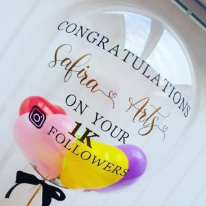 personalised balloon filled with min balloons